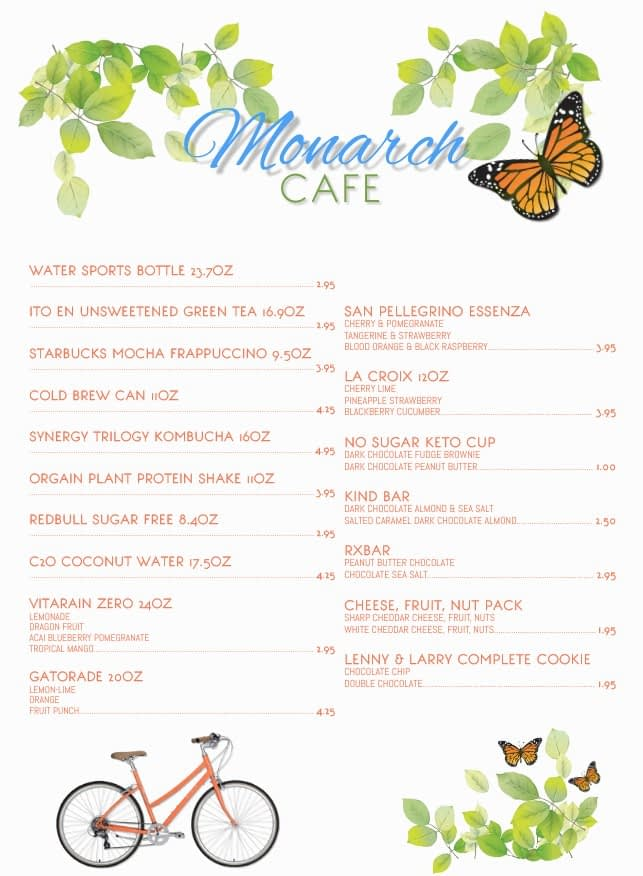 a cafe menu with butterflies and plats and a bicycle