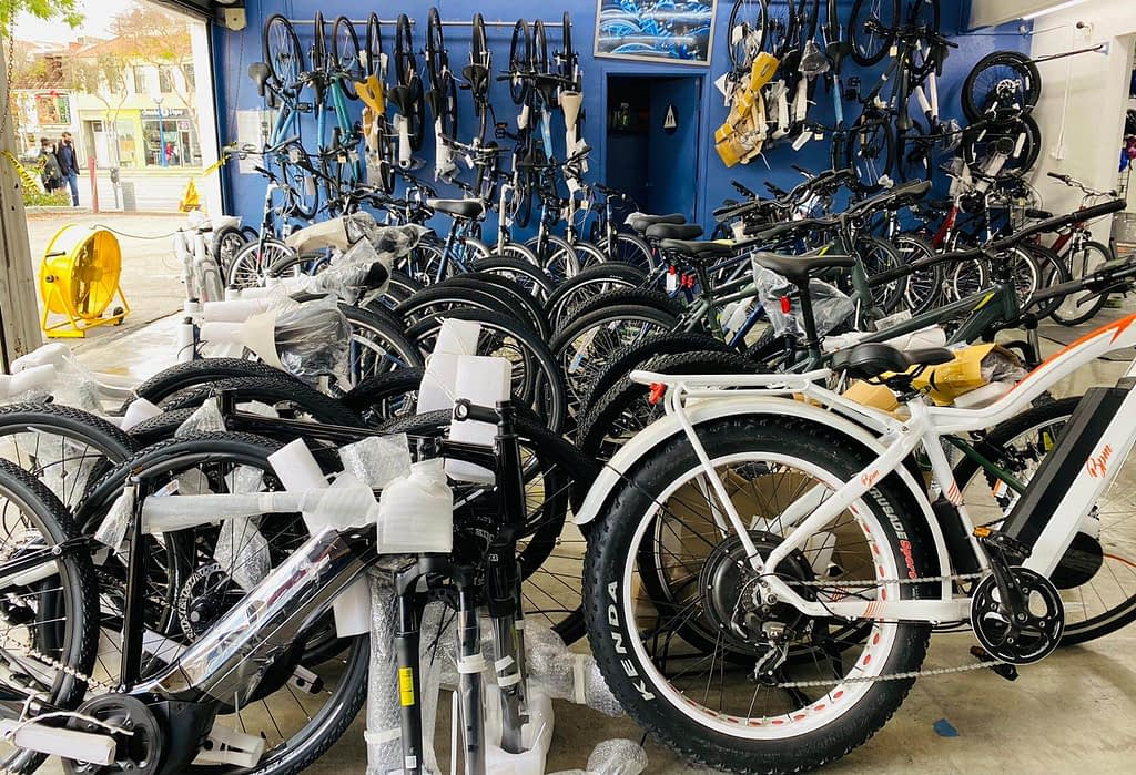 a group of new bikes waiting to be built in a bike shop