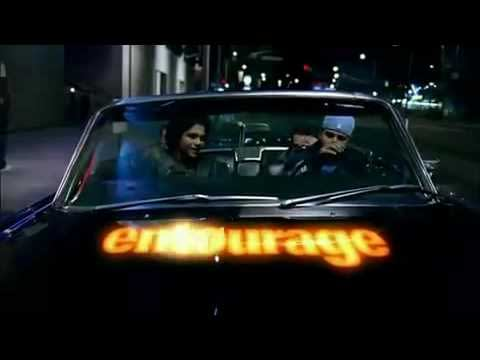 four friends in a cool car at night with the word entourage on the hood of the car