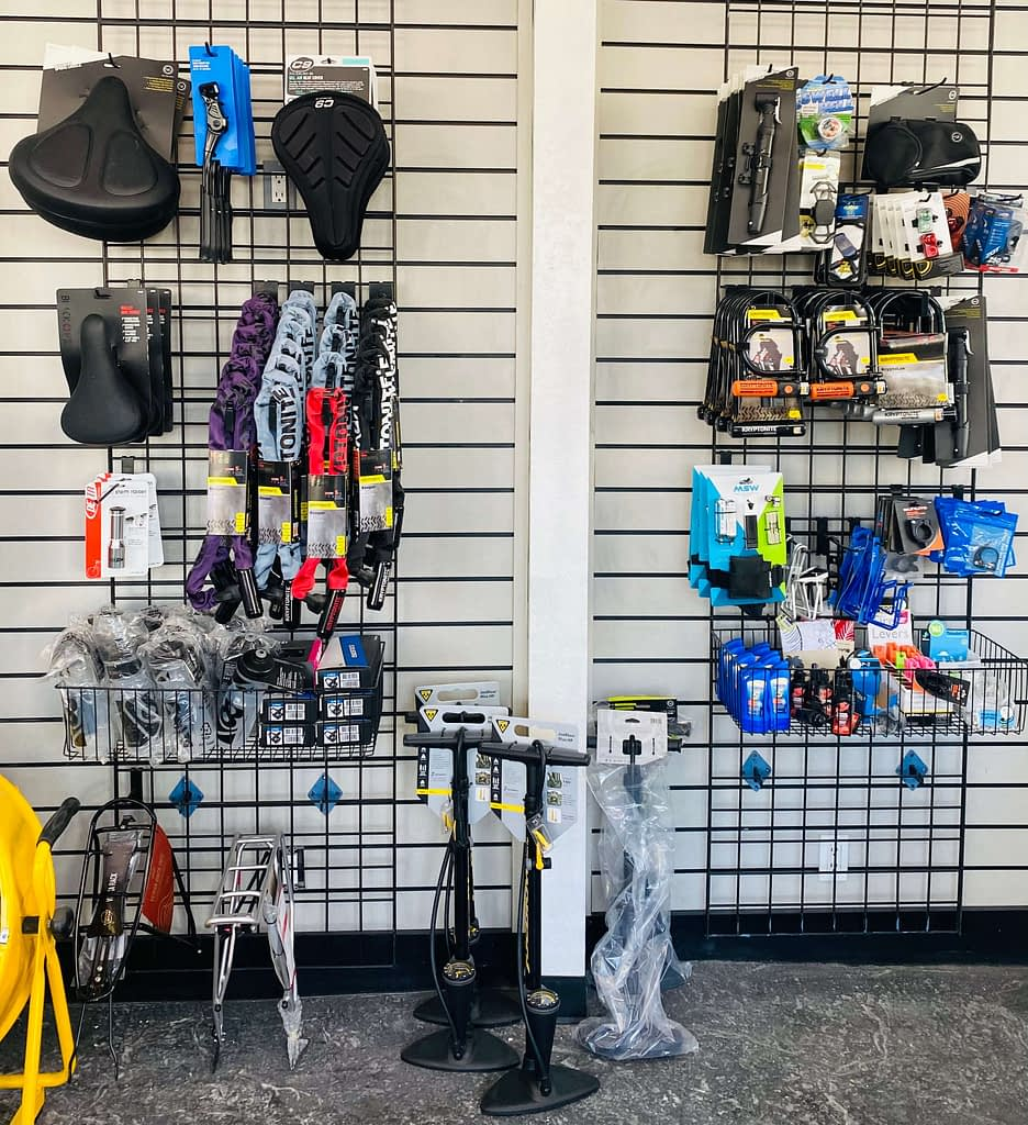 bike accessories hanging up inside of a bike shop
