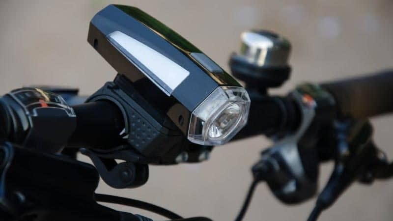a close up of a black bicycle light