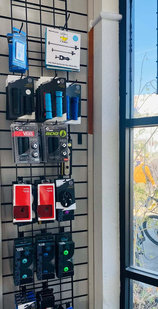 accessories hanging on the wall in the interior of a bike shop
