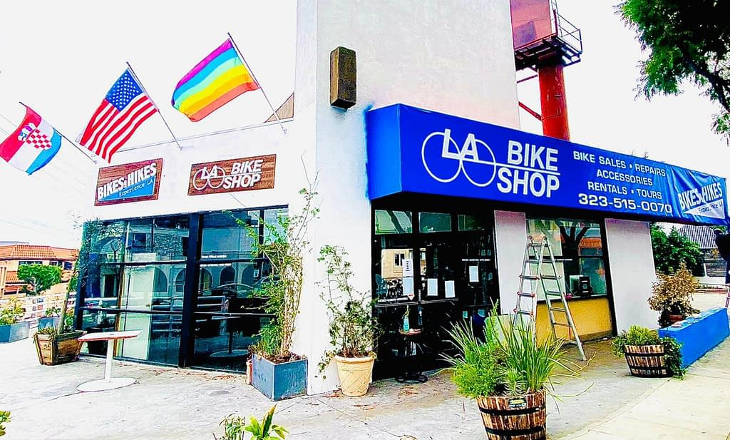 flags waving outside of a bike shop in los angeles