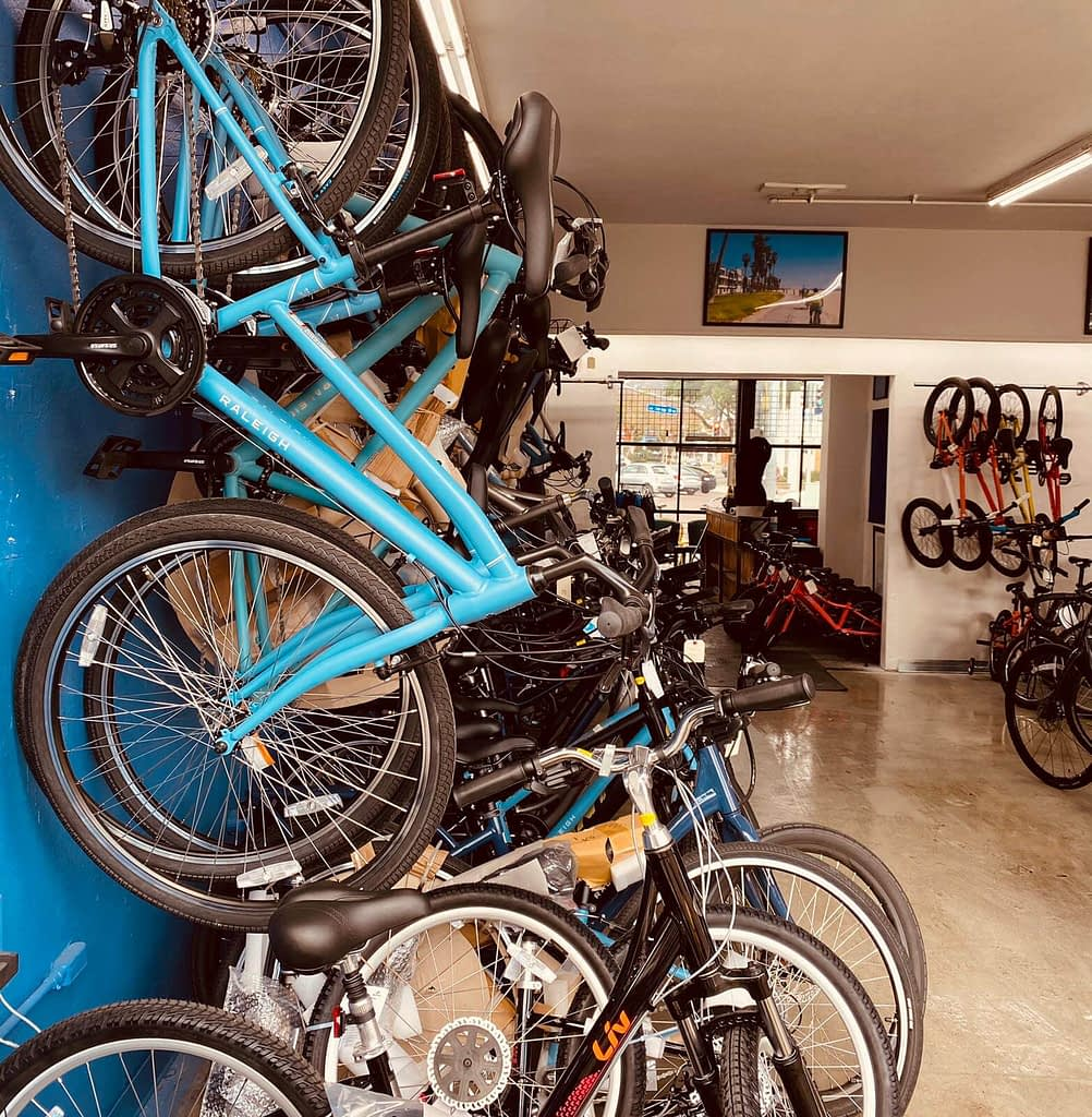 a wall of bikes in a bike shop