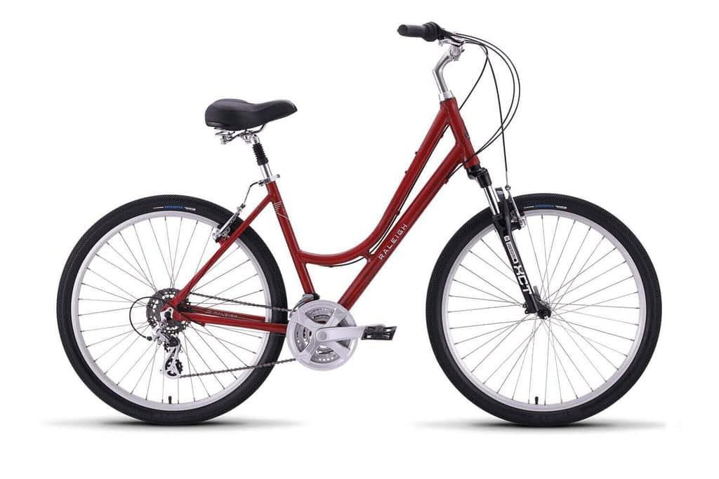 a red and silver raleigh step through bicycle