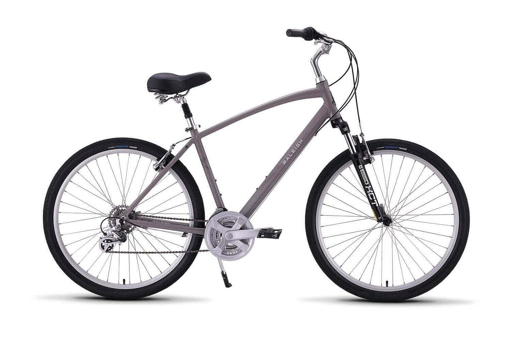 a grey raleigh venture 2 bicycle with black wheels